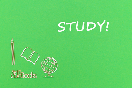 concept school for kids, text study, school supplies wooden miniatures on green backboard