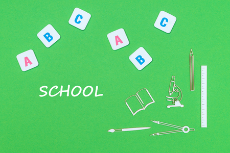 concept school, text school, school supplies wooden minitures, abc letters on green backboard