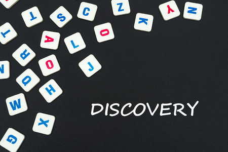 english school concept, text discovery, colored square english letters scattered on blackboard