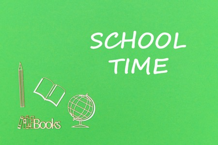 concept school for kids, text school time, school supplies wooden miniatures on green backboard Stock Photo