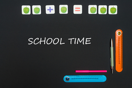 Concept school, black art table with stationery supplies with text school time on blackboard Stock Photo