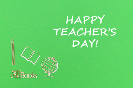 concept school for kids, text happy teachers day, school supplies wooden miniatures on green backboard