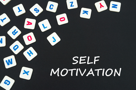 english school concept, text self motivation, colored square english letters scattered on blackboard