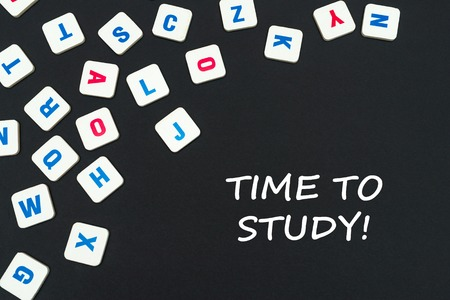 english school concept, text time to study, colored square english letters scattered on blackboard