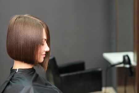 girl is waiting for hairdresser in hairdressing salon, hairstyle concept