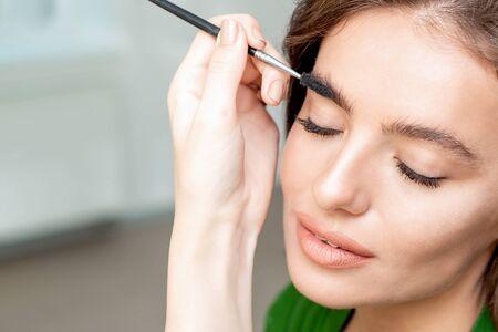 Eyebrows makeup for woman with eyebrow brush tool.