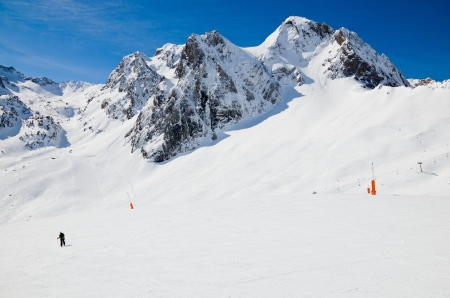 Snow downhills with skiers are photographed in the winter Pyrenees  photo