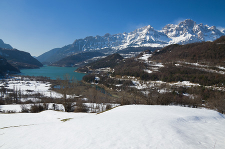 Winter mountains are photographed in the neighborhood of Panticosa  There is an artificial lake  Embalse de Bubal  in the Valle de Tena in Huesca, Aragon in Spain  photo