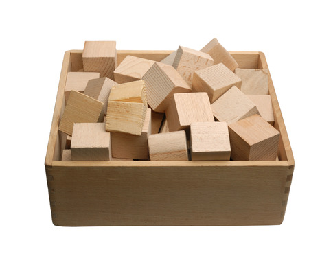 heaped: Construction set with wood blocks heaped up