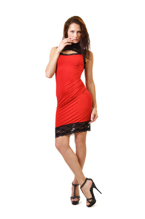 Young woman is wearing a red dress with black lace photo