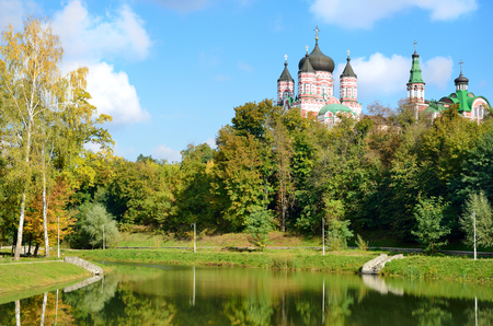 Feofaniya is the youngest garden in Kiev . This is a beautiful sample of the landscape architecture  Panteleymonovsky cathedral towers under it  photo