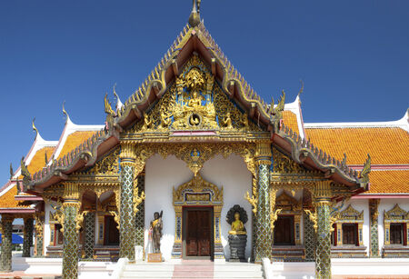 ���clear sky���: An ornate Buddhist temple under the clear sky of Thailand Stock Photo