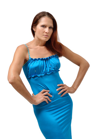 wrathful: She stands akimbo and looks intently at the camera  She is a blue dress  Stock Photo