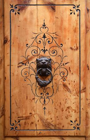 doorhandle: Massive wood door is decorated with Aragon motives. It has a door-handle hammered in the form of the lion head.
