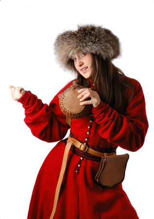 caftan: Young woman is wearing the vintage uniform of Tatar warrior of 17th century  a red caftan and a fur-cap   She is opening the leather flask  She has bag on the belt