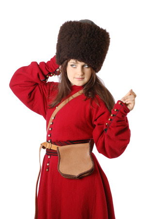 caftan: Young woman is wearing the vintage uniform of the Tatar foot warrior of the 17th century  She is fitting a black fur cap  He is dressed in a red caftan  She has bag on the belt