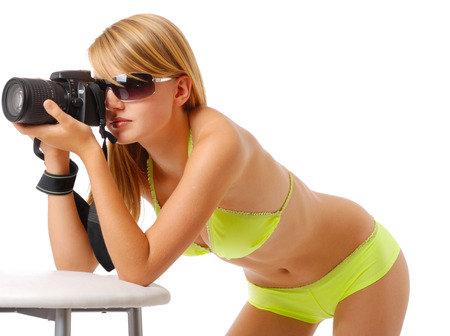 cut out device: An attractive girl is shooting with DSLR