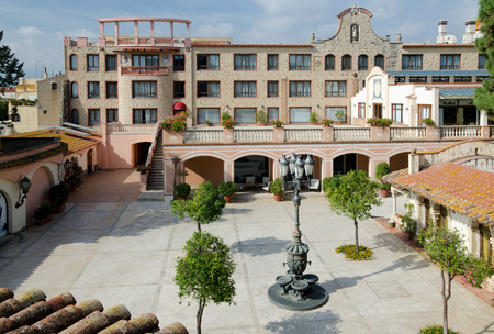 spa resort: A traditional courtyard is situated in the ancient Spanish estate within the spa resort  Editorial