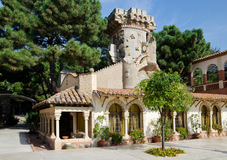 spa resort: A traditional building with a whimsical tower is situated in the ancient Spanish estate within the spa resort  Editorial
