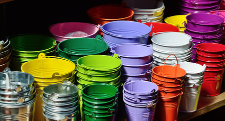 Many zinked pails are folded at each other  Stock Photo