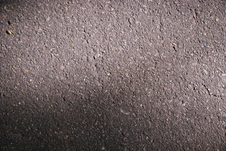 unevenly: Asphalt pavement is illuminated unevenly