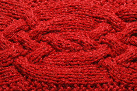 bulging: Red knitted cloth is made by hand  It is decorated with bulging braid