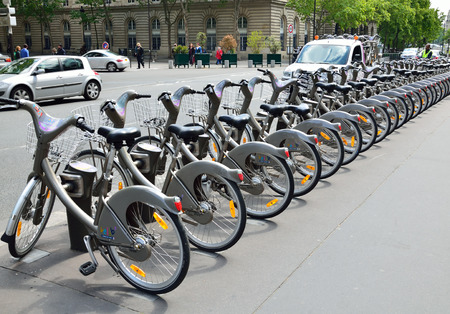 distinctive: This is Velib station with its distinctive grey bicycles  Velib is a large-scale public bicycle sharing system in Paris  Editorial
