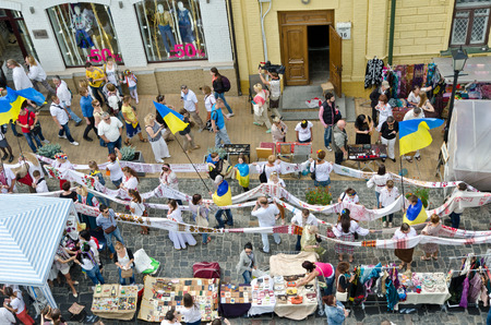 kyiv: Kiev, Ukraine - August 24 2014: Ukrainian people celebrate the Independence Day in the famous street Andriyivskyy uzviz in Kyiv.