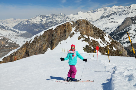 compacted: A skier-girl stopped on the ski run of compacted snow. Stock Photo