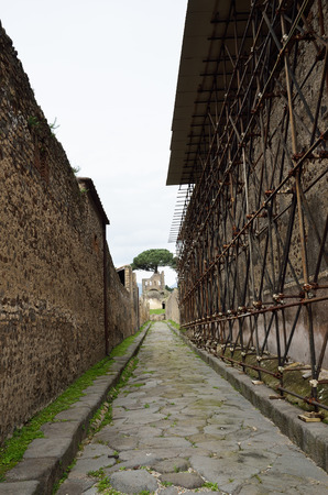 regenerated: Narrow paved street is recovered in the middle of Roman ruins.