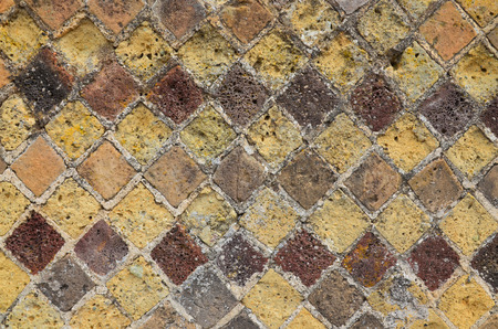 extant: The Roman tessellation remains on the ancient wall. A large collection of extant mosaics and frescoes were found at Pompeii. Stock Photo