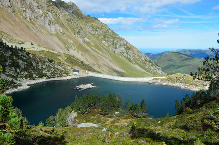 lac: An artificial lake (Lac de Greziolles) is formed with a dam on the Garet river in the valley Campan.