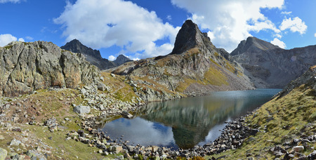 lac: The autumn sky and the peak are reflected on the water surface of the lake Lac d Stock Photo