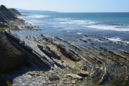 the surge: Permanent waves surge in the Atlantic coast. There are a steep sstone shore and a seabed at low tide in the vicinity of Saint-Jean-de-Luz.