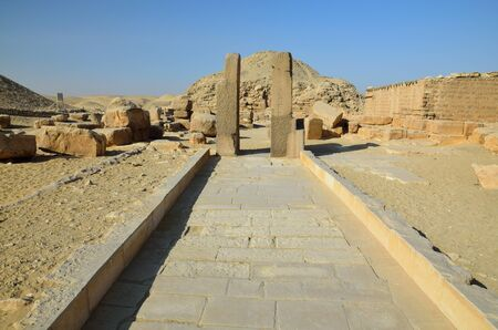 necropolis: An extant entrance of the ancient temple is situated in Saqqara necropolis, Giza, Egypt. Stock Photo