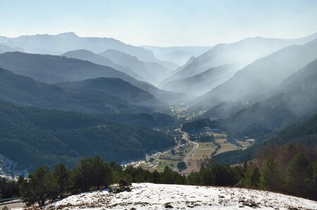 atmospheric phenomena: Winter fog overcasts the mountain valley and the forested slopes of the mountain ridges.