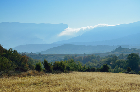 atmospheric phenomena: The Serra del Montsec is a mountain system of the PrePyrenees. The low clouds are carried across the ridge.