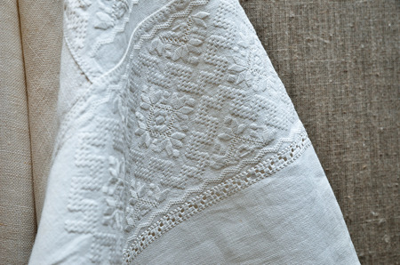 fancywork: The traditional whitework embroidery is made on the homespun sleeve of the ancient Ukrainian shirt. Stock Photo