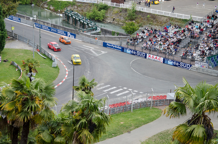 bystanders: Pau France  May 23 2015: Participants of Grand Prix Historique compete in the street of Pau.