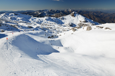 snug: A comfortable empty piste is in the middle of the snowy mountains. The ski resort Pierre Saint Martin is a perfect place for relax skiing in nature. It is settled on the west of Pyrenees. Stock Photo