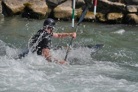 kayaker: Kayaker is moving across whitewater rapids.
