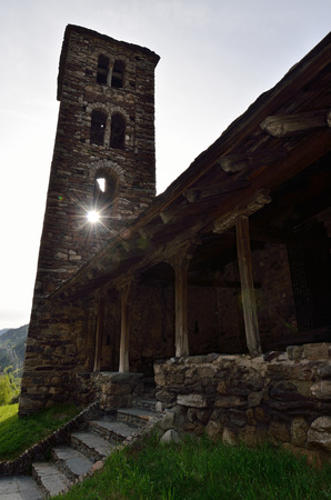 extant: The ancient Romanesque church is located in Canillo. It was built of rough stone in the XI - XII centuries. The sun is shining through the window of the bell-tower.