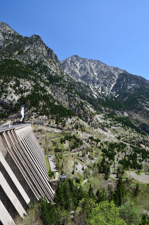 hydroelectric power station: A vertical concrete barrier of the hydroelectric power station is photographed in the Spanish Pyrenees.