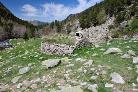 tourism in andorra: The small refuge is built from stones near the tourist pathway in the upper part of the Vall-de-Madriu-Perafita-Claror.