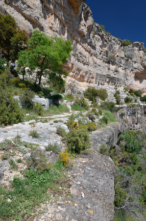 abrupt: Siurana is a world-class climbing destination. There are steep walls, slabs, overhangs and other limestone landforms in the Prades mountains.