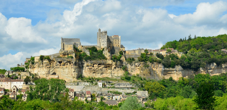 extant: The extant medieval castle is perched on top of a limestone cliff and dominating the town Beynac-et-Cazenac.