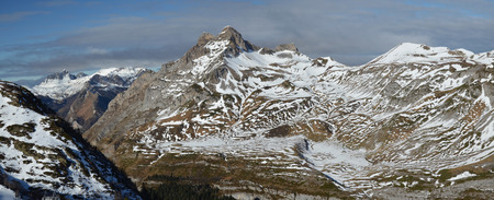 soft peak: The mountain range are slightly covered with snow in the vicinity of the ski resort Artouste in the Atlantic Pyrenees. Stock Photo