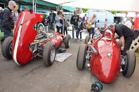 bystanders: Pau, France - May 24 2015: Participants of Grand Prix Historique prepare their bolide racing cars for start of competition. Editorial