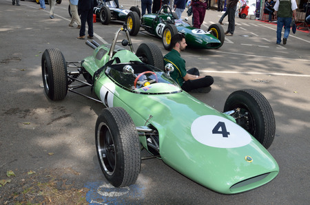 bystanders: Pau, France - May 24 2015: Participants of Grand Prix Historique wait near their bolide racing cars for start of competition. Editorial