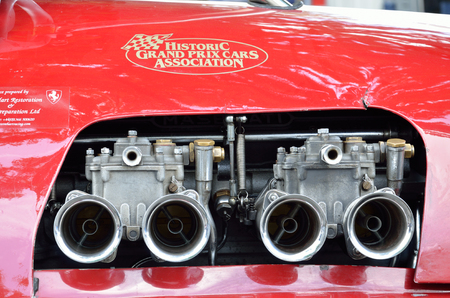 tailpipe: The red vintage bolide is photographed with the sign of his association at racing Grand Prix Historique.